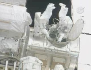 Astronauts Battle Stubborn Cable, Power Outage in Spacewalk