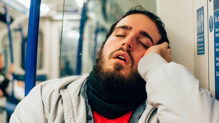 A man sleeping on the tube