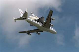 The Space Shuttle orbiter Endeavour flies atop NASA's Boeing 747 Shuttle carrier Aircraft as it returns on March 7, 1997 from a lengthy maintenance period.