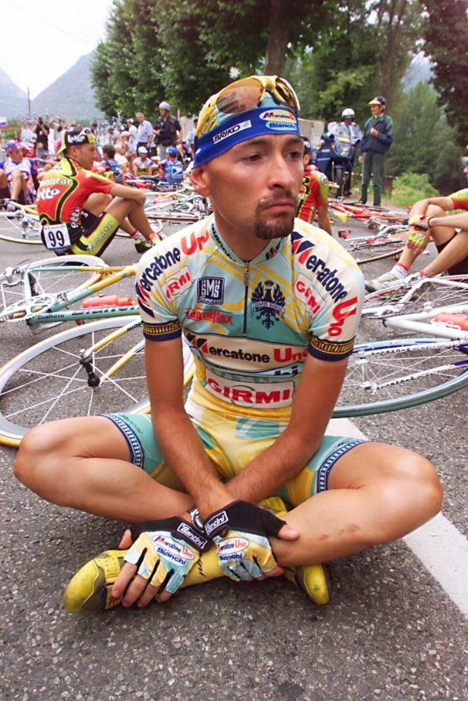 Marco Pantani sits down as riders protest at the 1998 Tour de France