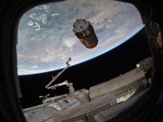 Japan's HTV-2 robotic cargo ship is seen just before astronauts grapple it on Jan. 27, 2011.