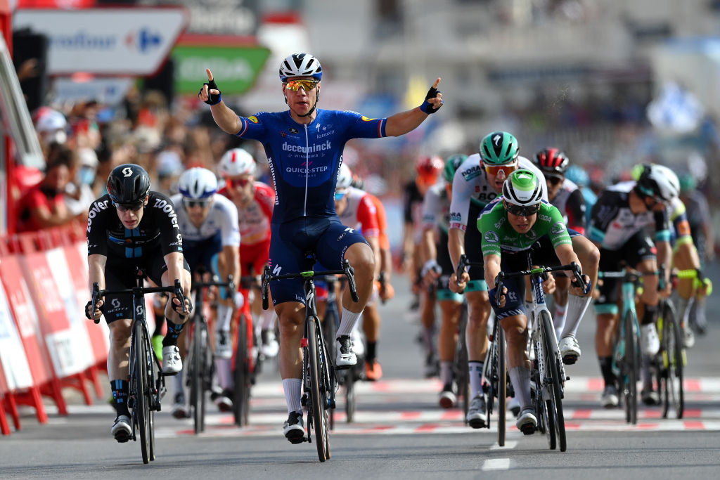 LA MANGA SPAIN AUGUST 21 Fabio Jakobsen of Netherlands and Team Deceuninck QuickStep celebrates winning ahead of Alberto Dainese of Italy and Team DSM and Jasper Philipsen of Belgium and Team AlpecinFenix green points jersey during the 76th Tour of Spain 2021 Stage 8 a 1737 km stage from Santa Pola to La Manga del Mar Menor lavuelta LaVuelta21 on August 21 2021 in La Manga Spain Photo by Stuart FranklinGetty Images