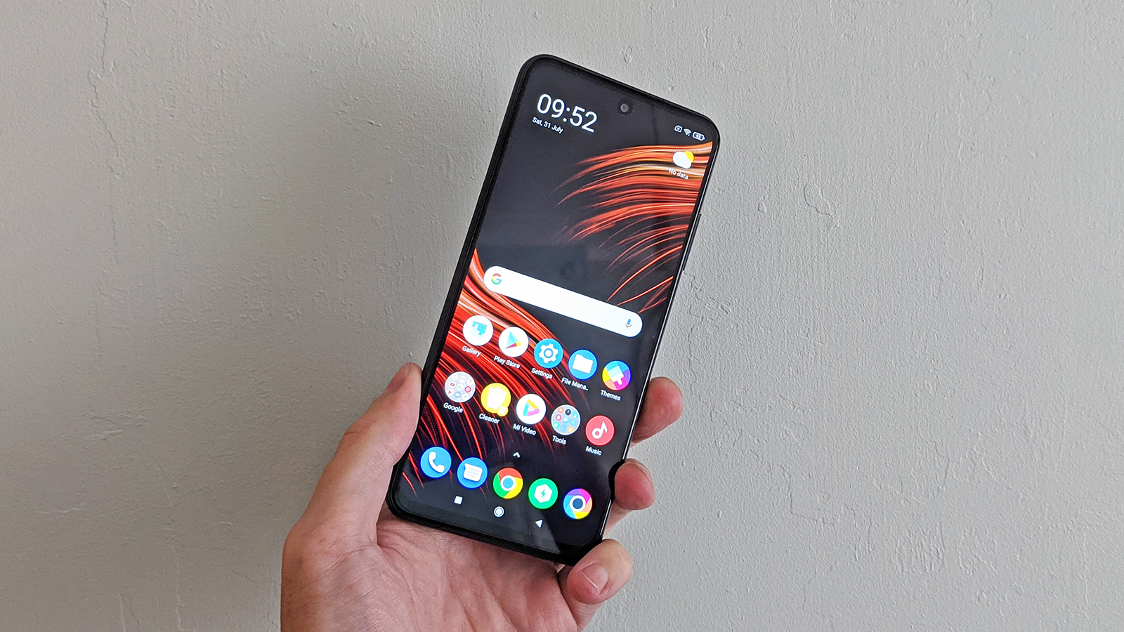 The Poco M3 Pro 5G from the front, held in someone's hand