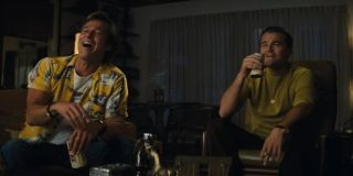 Once Upon A Time In Hollywood Brad Pitt and Leonardo DiCaprio laugh over some drinks in the living r