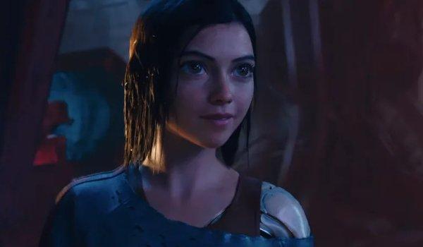 Alita: Battle Angel Alita smiling in the sunken ship, soaked to the bone