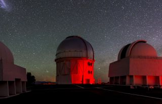 The Dark Energy Camera is mounted on the Victor Blanco telescope, pictured here with other telescopes at the Cerro Tololo Inter-American Observatory in Chile.