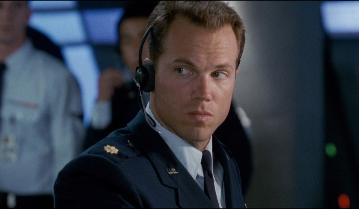 Independence Day Adam Baldwin sits with a headset on