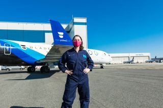 """Space.com's Chelsea Gohd stands in front of """"G-Force One,"""" preparing for a weightless """"zero gravity"""" flight aboard the customized Boeing 727 aircraft."""