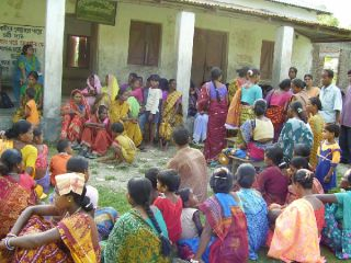 Women in a government loan program meet to discuss witch hunts in India's Jalpaiguri district.