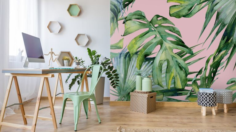 pink tropical feature wall in study with wooden floor and desk