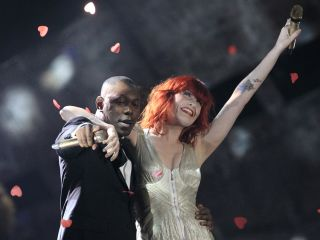 Dizzee Rascal and Florence Welch on stage at the 2010 Brit Awards.