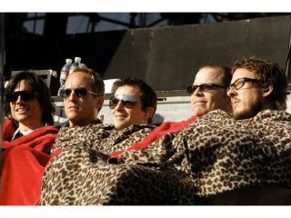 Weezer get snuggly with Josh Freese second from left