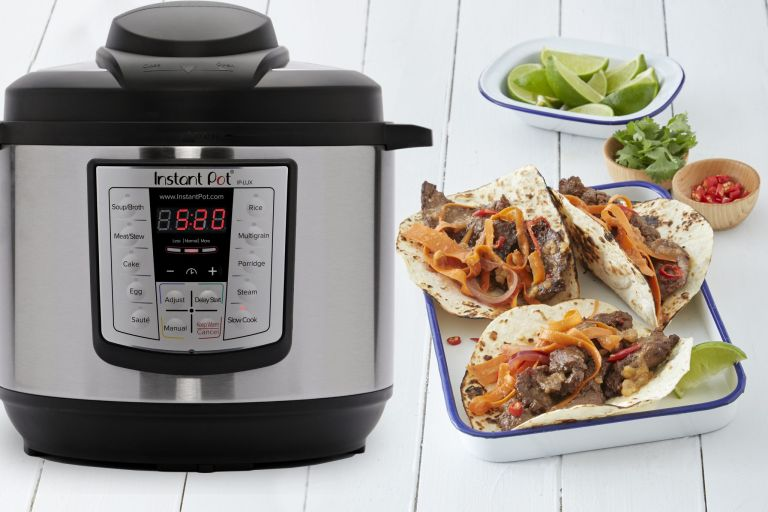 Instant Pot Lux 8 Quart on side with cooked tacos