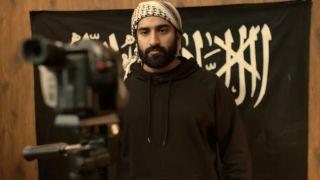 A jihadi poses with a gun