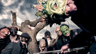 Big Big Train wearing masks to promote their Folklore album