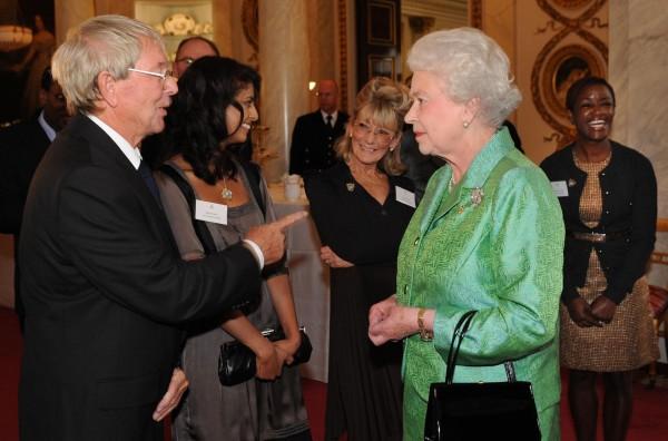 Queen Elizabeth II receiving Blue Peter presenter John Noakes