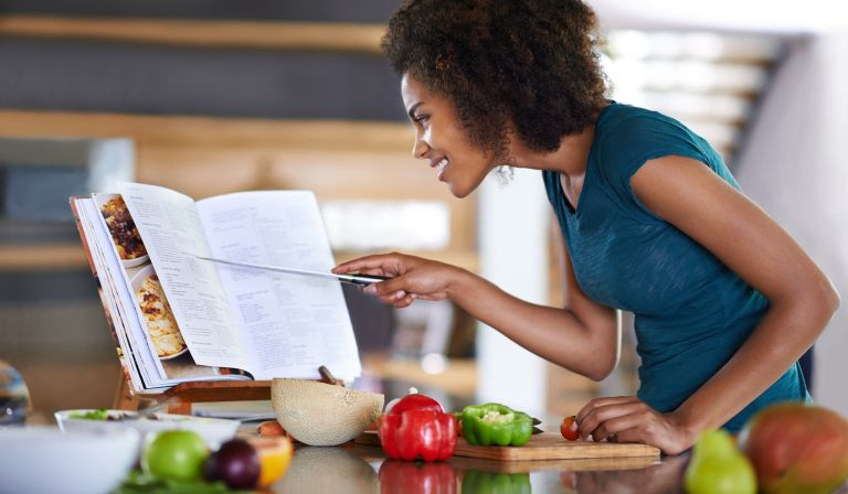 Woman uses one of the best vegan cookbooks