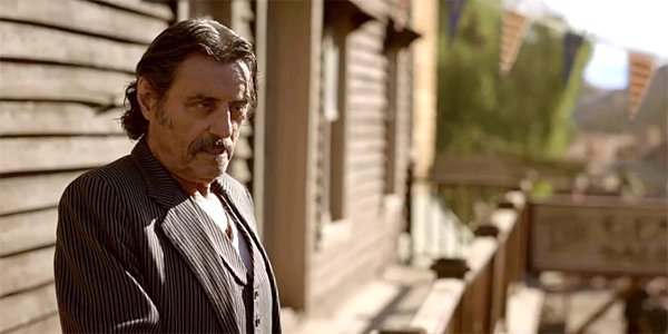 Ian McShane stares down as Al Swearengen in Deadwood: The Movie HBO