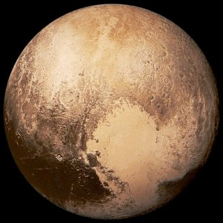 """Pluto's famous """"heart,"""" as seen by NASA's New Horizons spacecraft during its 2015 flyby of the dwarf planet."""