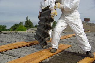 corrugated cement asbestos roof tiles being safely removed