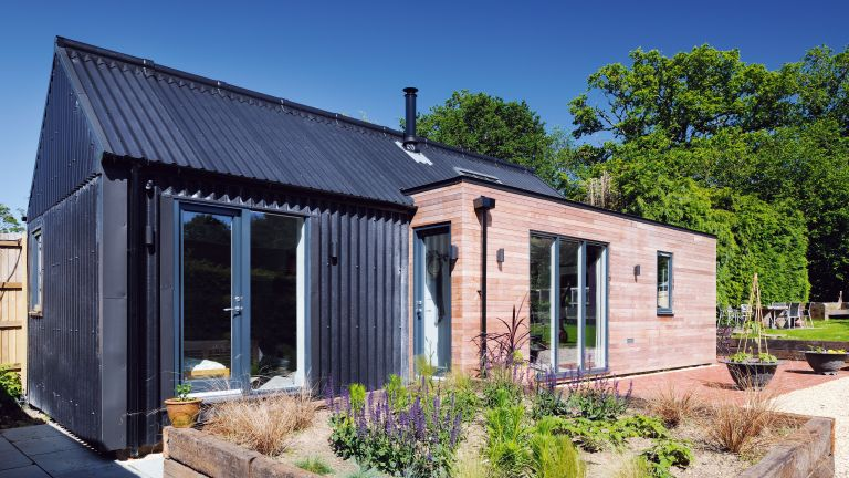 Contemporary annexe clad in timber and metal
