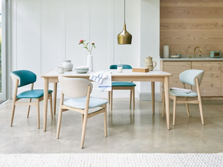 dining room with contemporary wooden furniture made light with the use of sunpipes image by nest