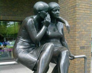 Two women whispering statue, gossip, secrets