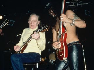 Les Paul and Slash jam onstage in 1996