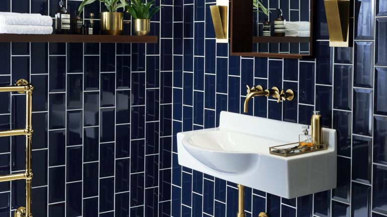 industrial style white sink infront of blue metro tiles