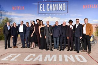 "WESTWOOD, CALIFORNIA - OCTOBER 07: Ted Sarandos, Cindy Holland, Vince Gilligan, Charles Baker, Krysten Ritter, Matt Jones, Betsy Brandt, Aaron Paul, Dean Norris, Jonathan Banks, Giancarlo Esposito, Bryan Cranston, and Jesse Plemons attend the Premiere of Netflix's ""El Camino: A Breaking Bad Movie"" at Regency Village Theatre on October 07, 2019 in Westwood, California."