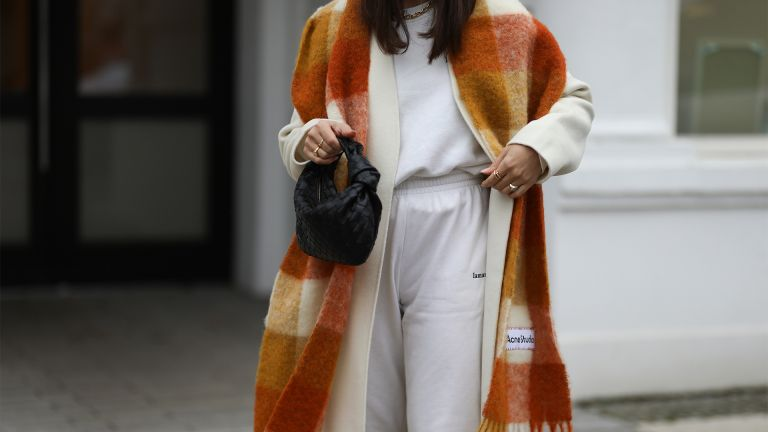 HAMBURG, GERMANY - JANUARY 14: Milena Karl wearing La Marel Jogger, Anine Bing coat, Acne Sudios scarf and Bottega Veneta bag on January 14, 2021 in Hamburg, Germany. (Photo by Jeremy Moeller/Getty Images)