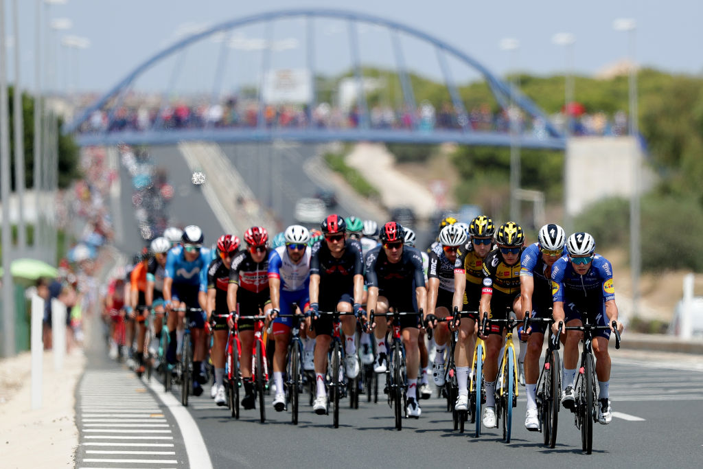 The Vuelta peloton rides steady behind the break