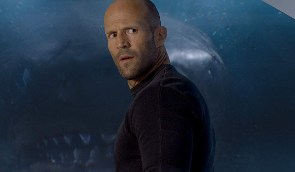 The Meg Jonas looks back in disbelief, as the image of the Megalodon is projected in front of him
