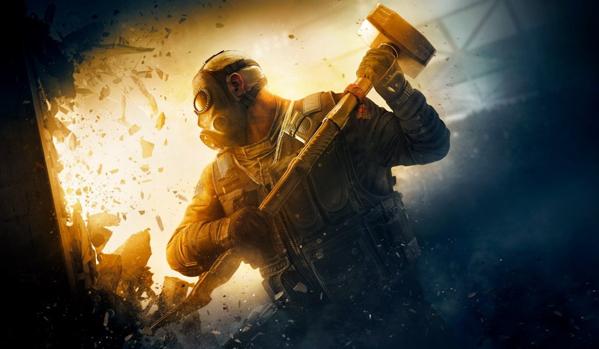 A soldier ready to swing a sledgehammer in Rainbow Six Siege.