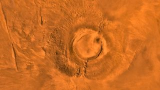 This digital-image mosaic of Mars' Tharsis plateau shows the extinct volcano Arsia Mons. It was assembled from images that the Viking 1 Orbiter took during its 1976 to 1980 working life at Mars.