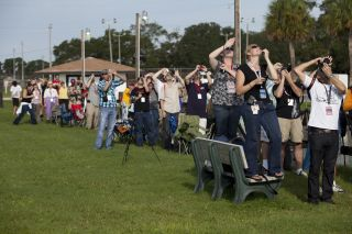 At KARS Park 1 on Merritt Island in Florida, a group of Tweetup participants watch excitedly as a Delta 2 Heavy rocket lifts off at 9:08 a.m. EDT on Sept. 10, 2011, carrying NASA's Gravity Recovery and Interior Laboratory (GRAIL) mission to the moon. The