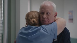 Robyn hugs a sad and worried looking Charlie in Casualty
