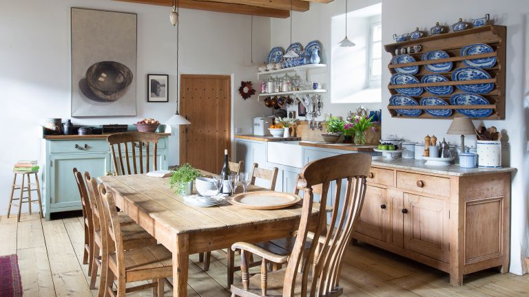 Rustic kitchen with pine table and open shelves