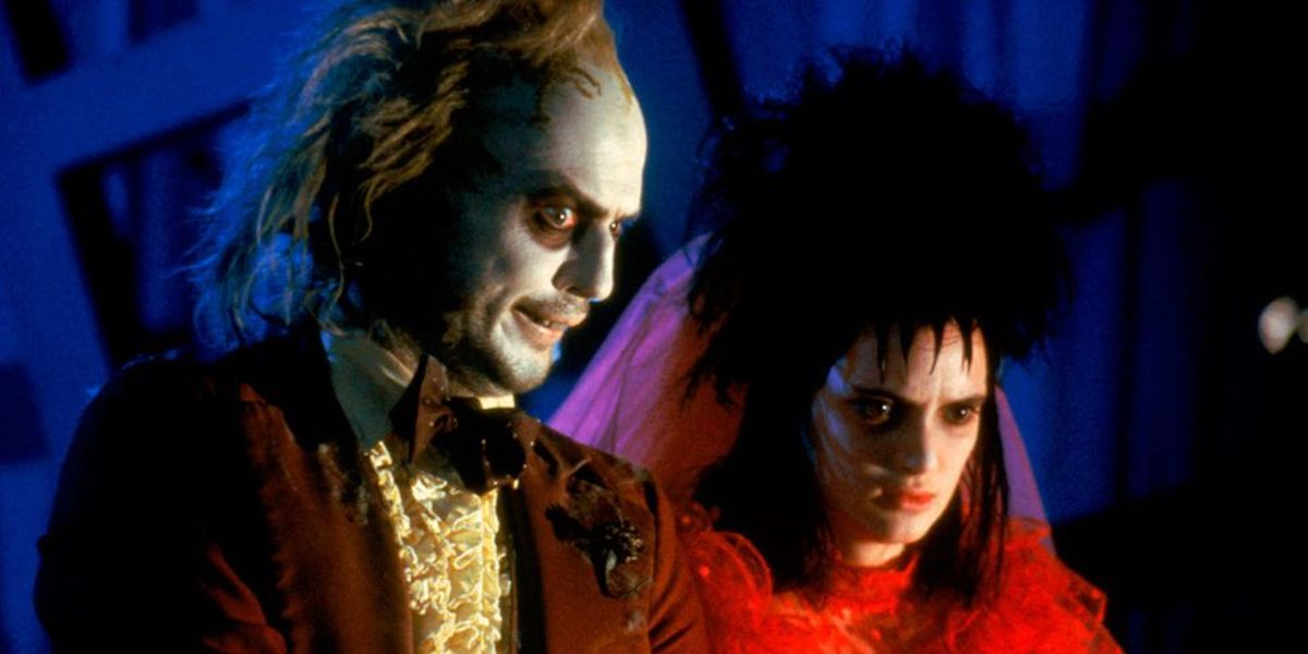 Michael Keaton and Winona Ryder in Beetlejuice (1988)