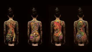 Four women with tattooed backs