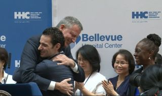 Dr. Craig Spencer hugs New York City Mayor Mayor Bill de Blasio.