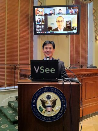 Milton Chen demonstrates VSee for the U. S. House of Representatives.