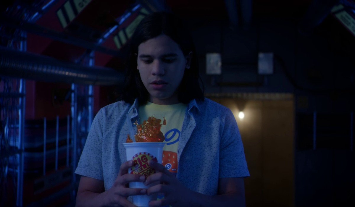 Cisco looking at a drink floating The Flash CW