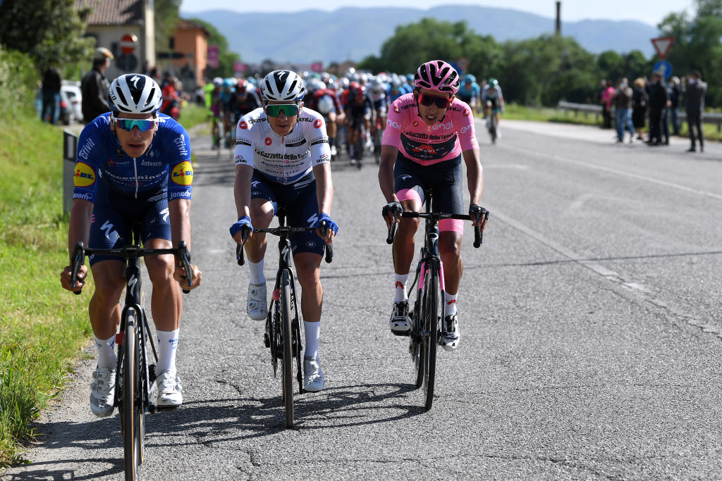FOLIGNO ITALY MAY 17 Joao Almeida of Portugal and Team Deceuninck QuickStep Remco Evenepoel of Belgium and Team Deceuninck QuickStep white best young jersey Egan Arley Bernal Gomez of Colombia and Team INEOS Grenadiers Pink Leader Jersey during the 104th Giro dItalia 2021 Stage 10 a 139km stage from LAquila to Foligno girodiitalia Giro on May 17 2021 in Foligno Italy Photo by Tim de WaeleGetty Images