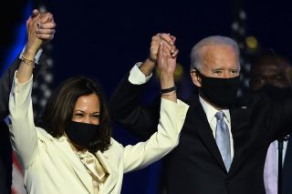U.S. President-elect Joe Biden and Vice President-elect Kamala Harris stand onstage after delivering remarks in Wilmington, Delaware, on Nov. 7, 2020, after being declared the winners of the presidential election.