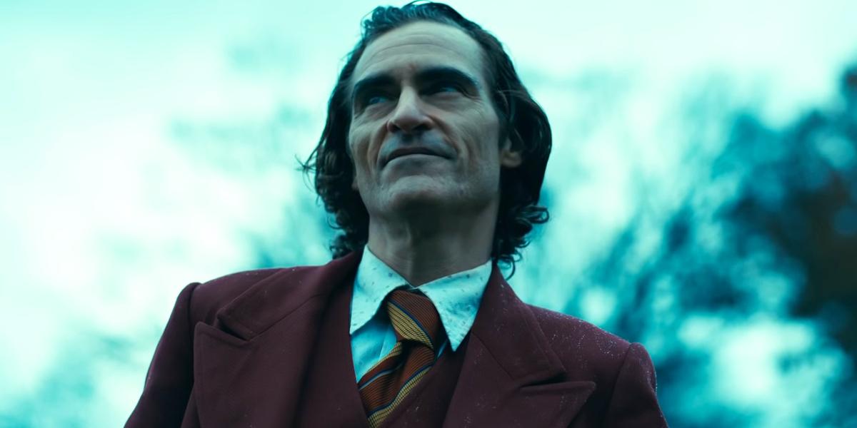 Joker Arthur Fleck smiling in the rain