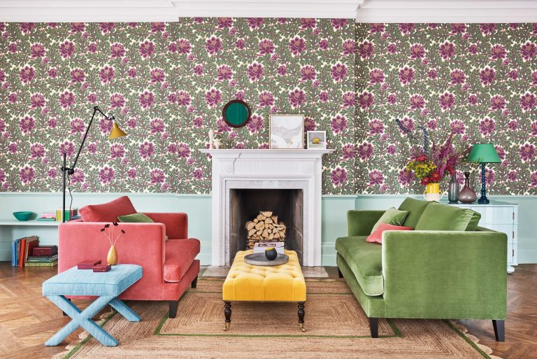 wall patterns created with floral wallpaper in living room featuring velvet sofas in bright colours