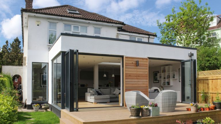Single storey rear extension ideas: house extension with cladding and bi fold doors lleading onto outdoor decking image by William Goddard