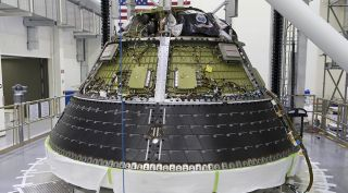The Orion crew module for the Artemis-1 (formerly EM-1) mission undergoing testing earlier this year. NASA expects to mate the crew and service modules later this month and ship the spacecraft to Plum Brook for thermal vacuum testing a couple months later.