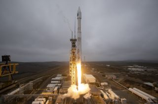 A United Launch Alliance Atlas V rocket launches the Landsat 9 satellite to orbit from Space Launch Complex 3 at Vandenberg Space Force Base in California, on Sept. 27, 2021.